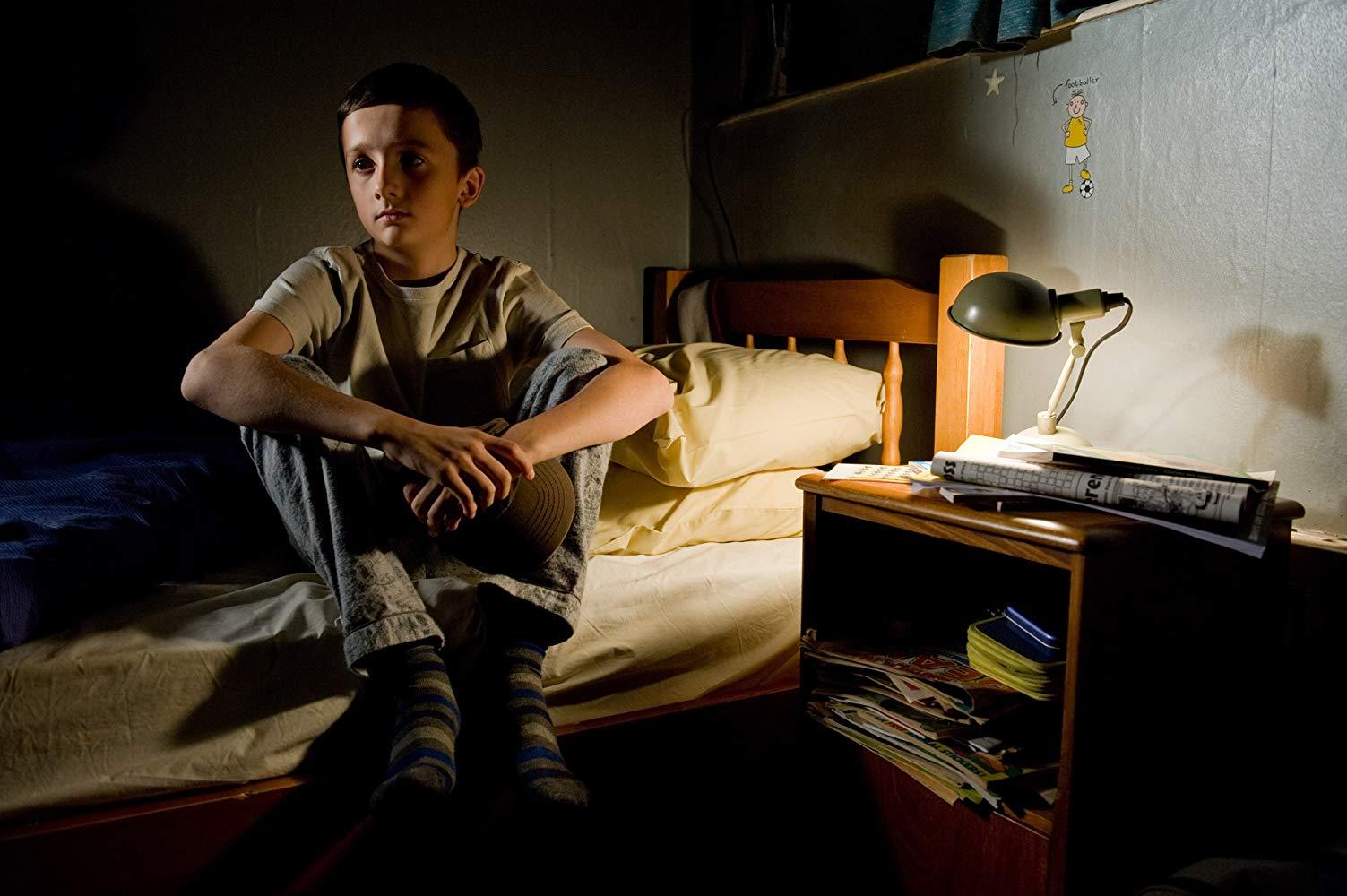 Grieving twin Marcus (Frankie McLaren & George McLaren) in Hereafter (2010)