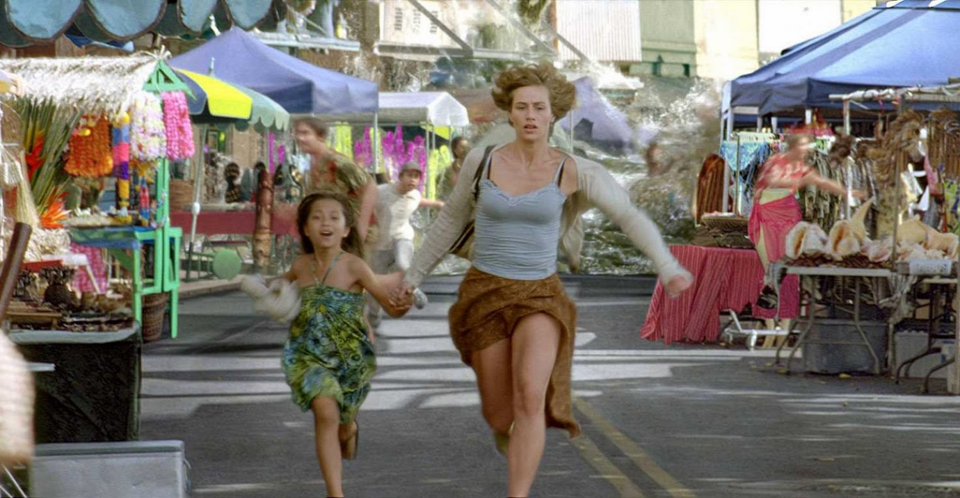 Cecile de France and a local girl flee from a tsunami in Hereafter (2010)