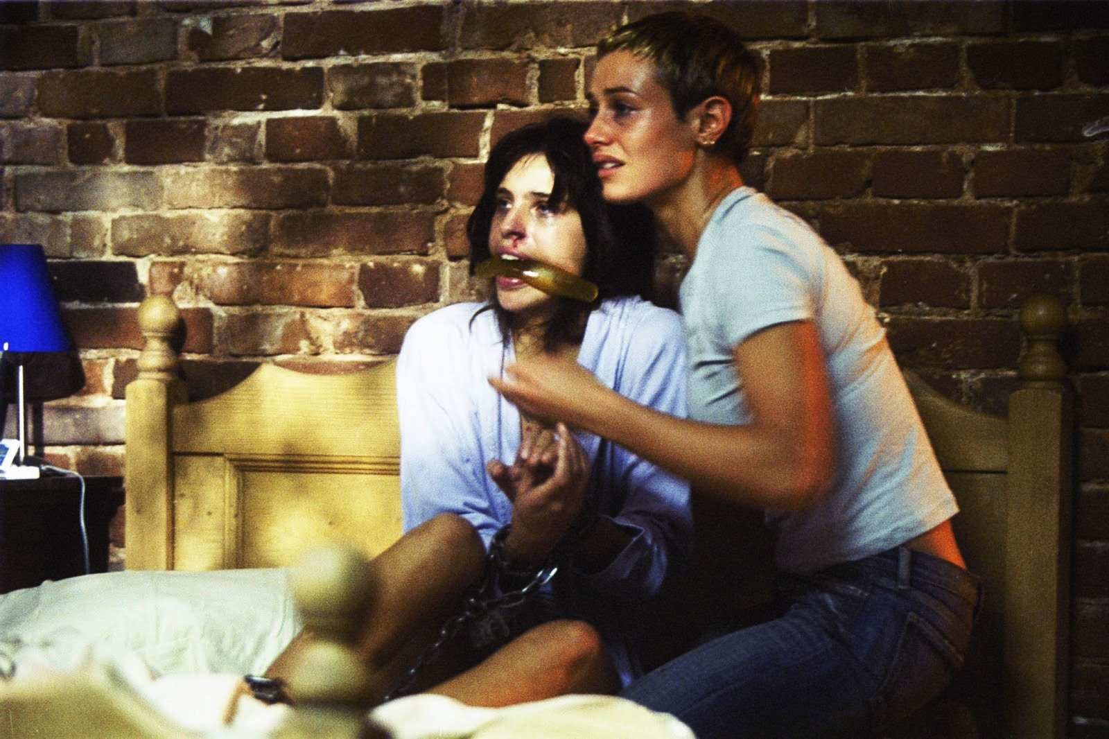 (l to r) Maiwenn and Cecile De France face a home invasion in High Tension (2003)