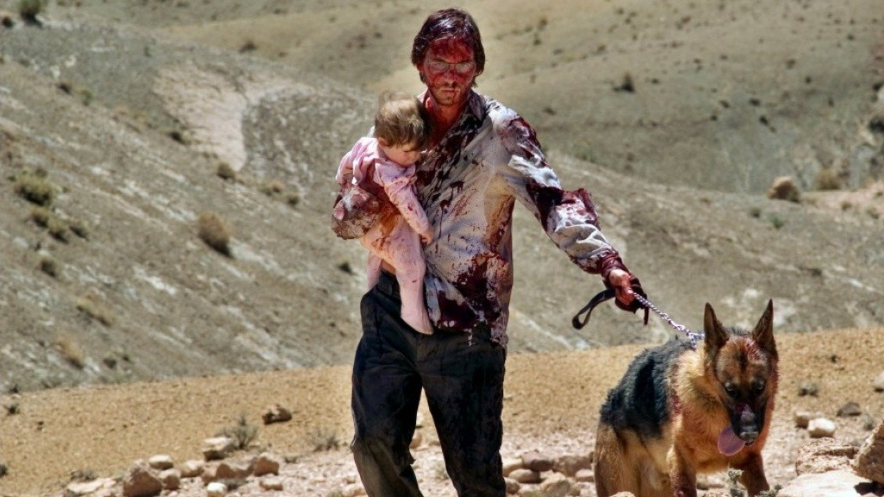 Aaron Stanford with baby and dog under assault in the New Mexico desert in The Hills Have Eyes (2006)
