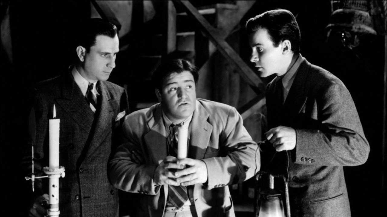 Bud Abbott, Lou Costello and Richard Carlson in a haunted house in Hold That Ghost (1941)
