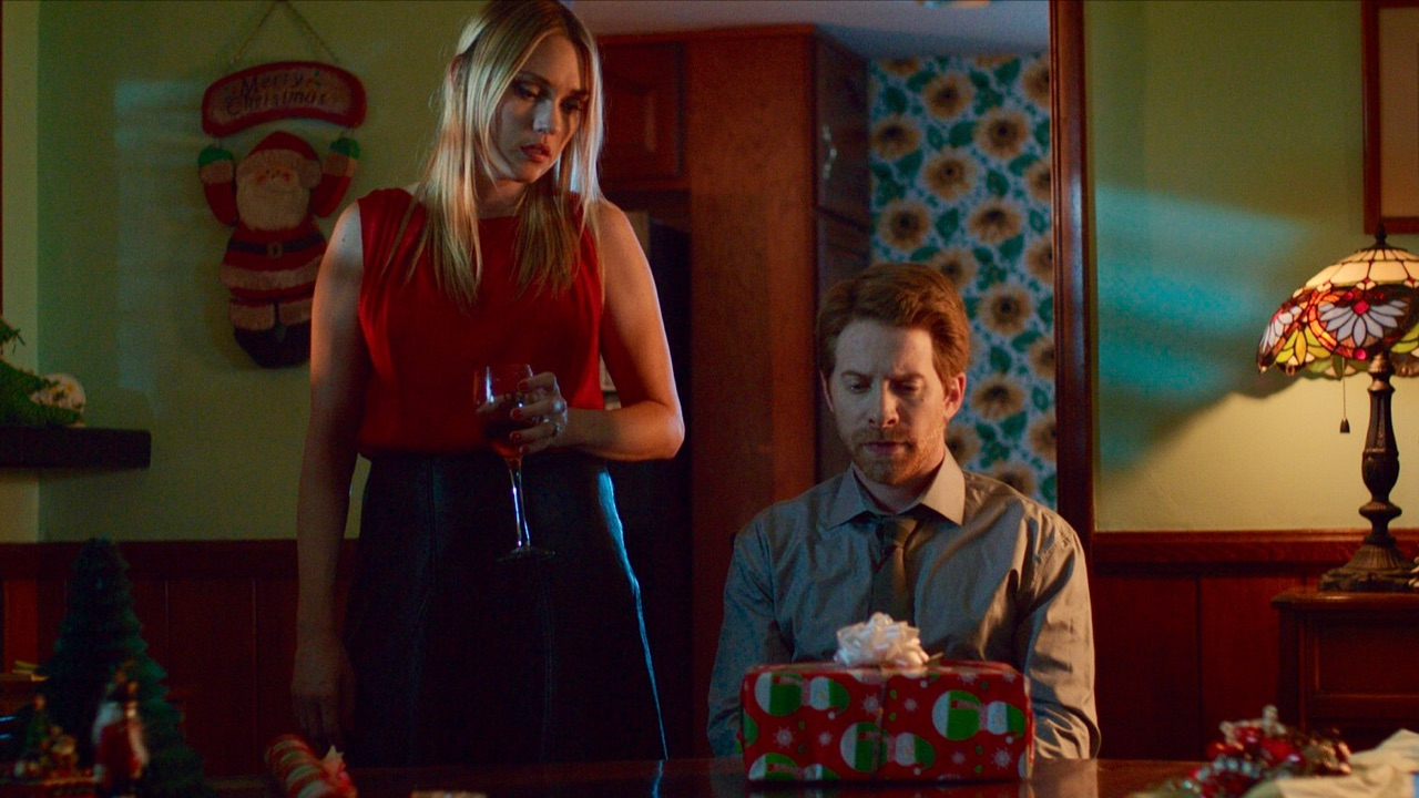 Parents Clare Grant and Seth Green prepare the Christmas present in the Christmas episode of Holidays (2016)