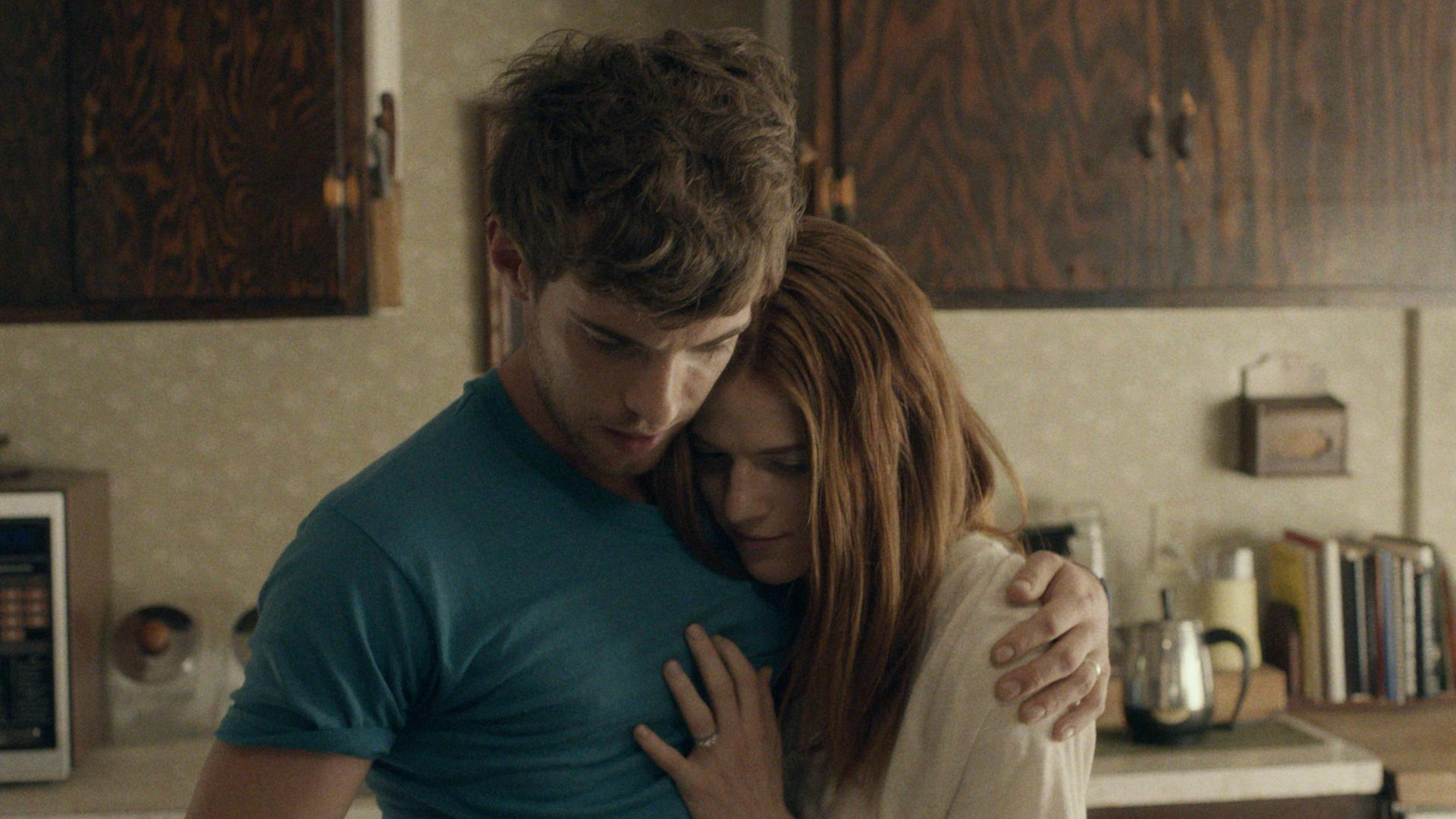 Newlyweds Harry Treadaway and Rose Leslie in a tender moment in Honeymoon (2014)