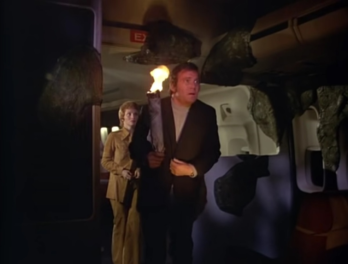 William Shatner and Lynn Loring face druidic stone on an airplane in The Horror at 37,000 Feet (1973)