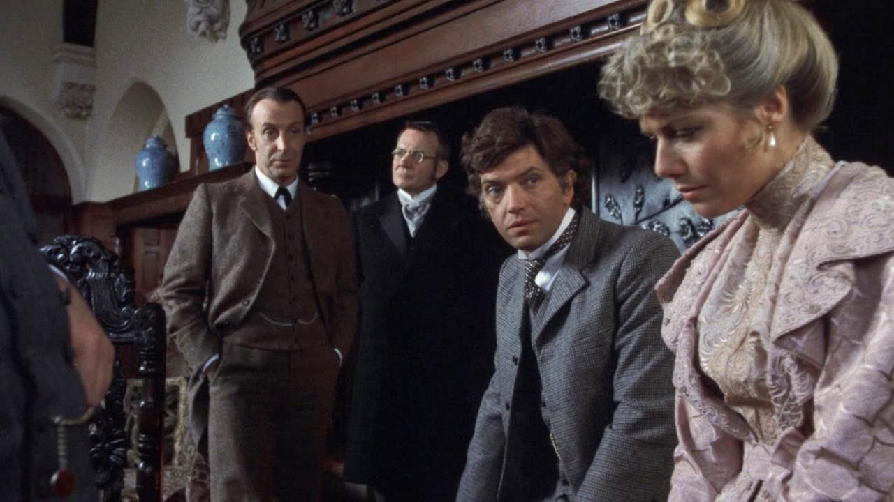 Sherlock Holmes (Ian Richardson), Dr Mortimer (Denholm Elliott), Sir Henry Baskerville (Martin Shaw) and Beryl Stapleton (Glynis Barber) in The Hound of the Baskervilles (1983)