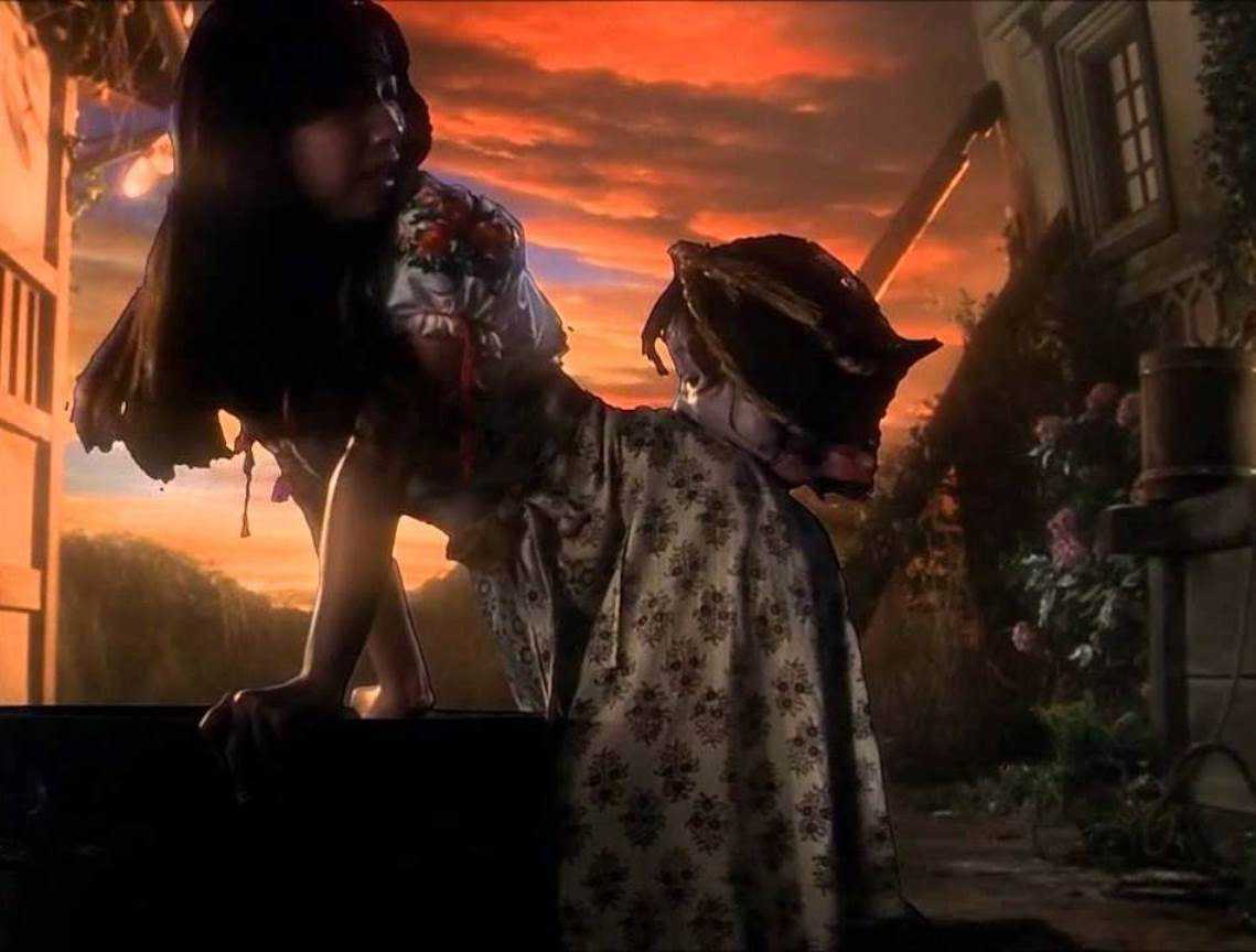 Kimiko Ikegami bitten on the butt by a flying head in House (1977)