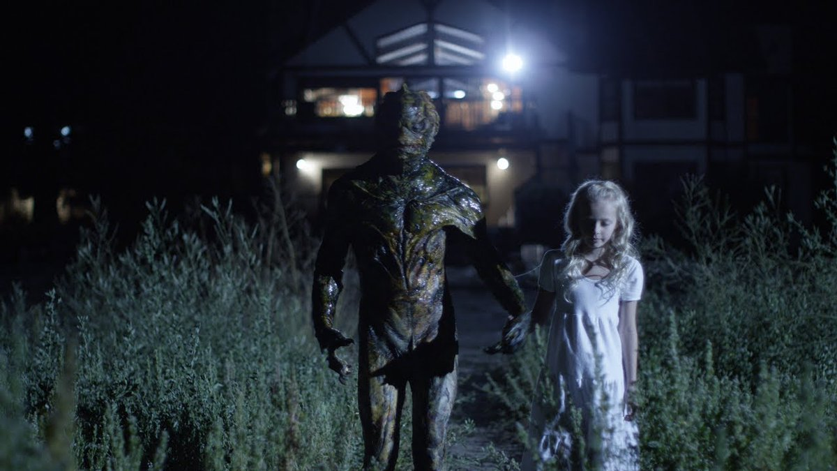 Young Emma (Amiah Miller) and the Fish Man in House By the Lake (2017)