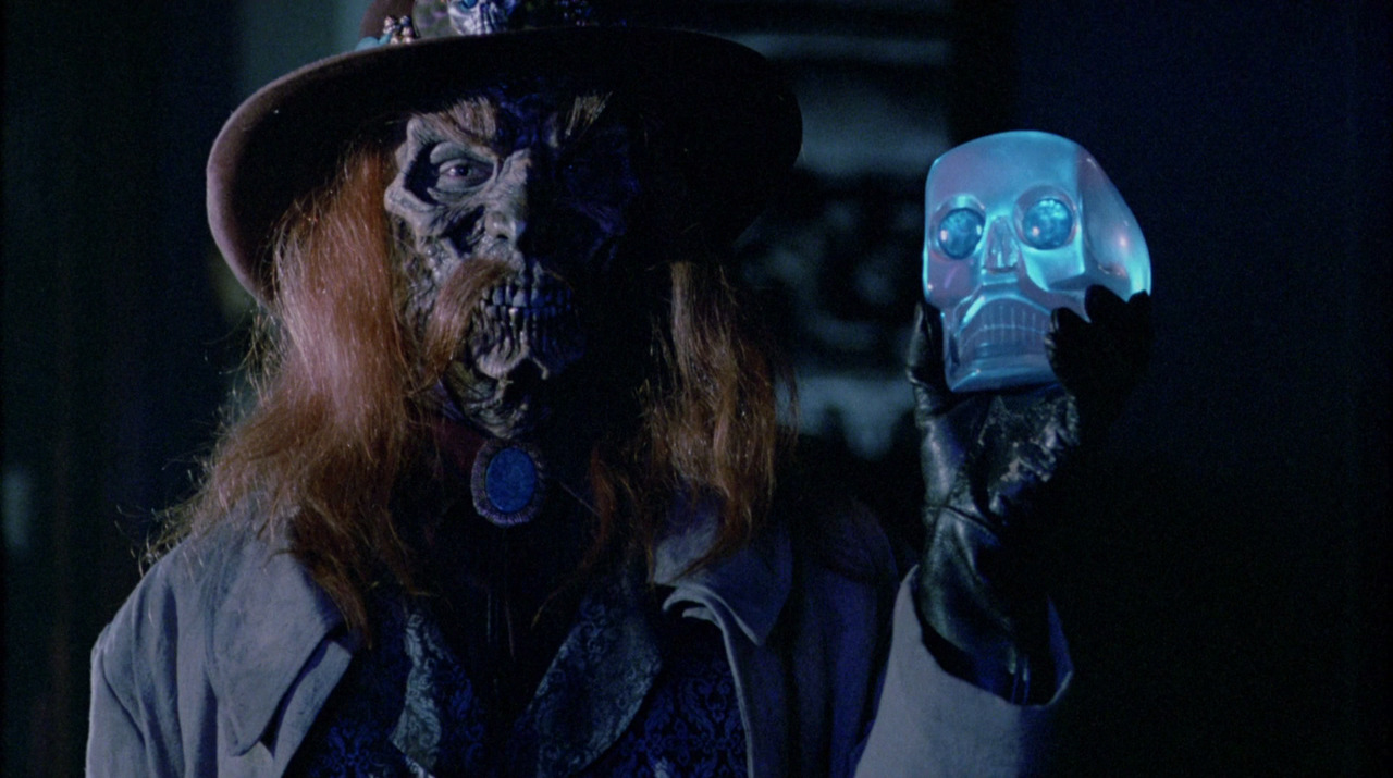 The resurrected Slim holding the crystal skull in House II: The Second Story (1987)