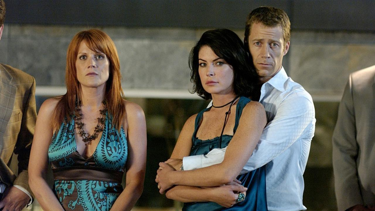 Lara Flynn Boyle, Colin Ferguson and Heather Hanson in The House Next Door (2006)