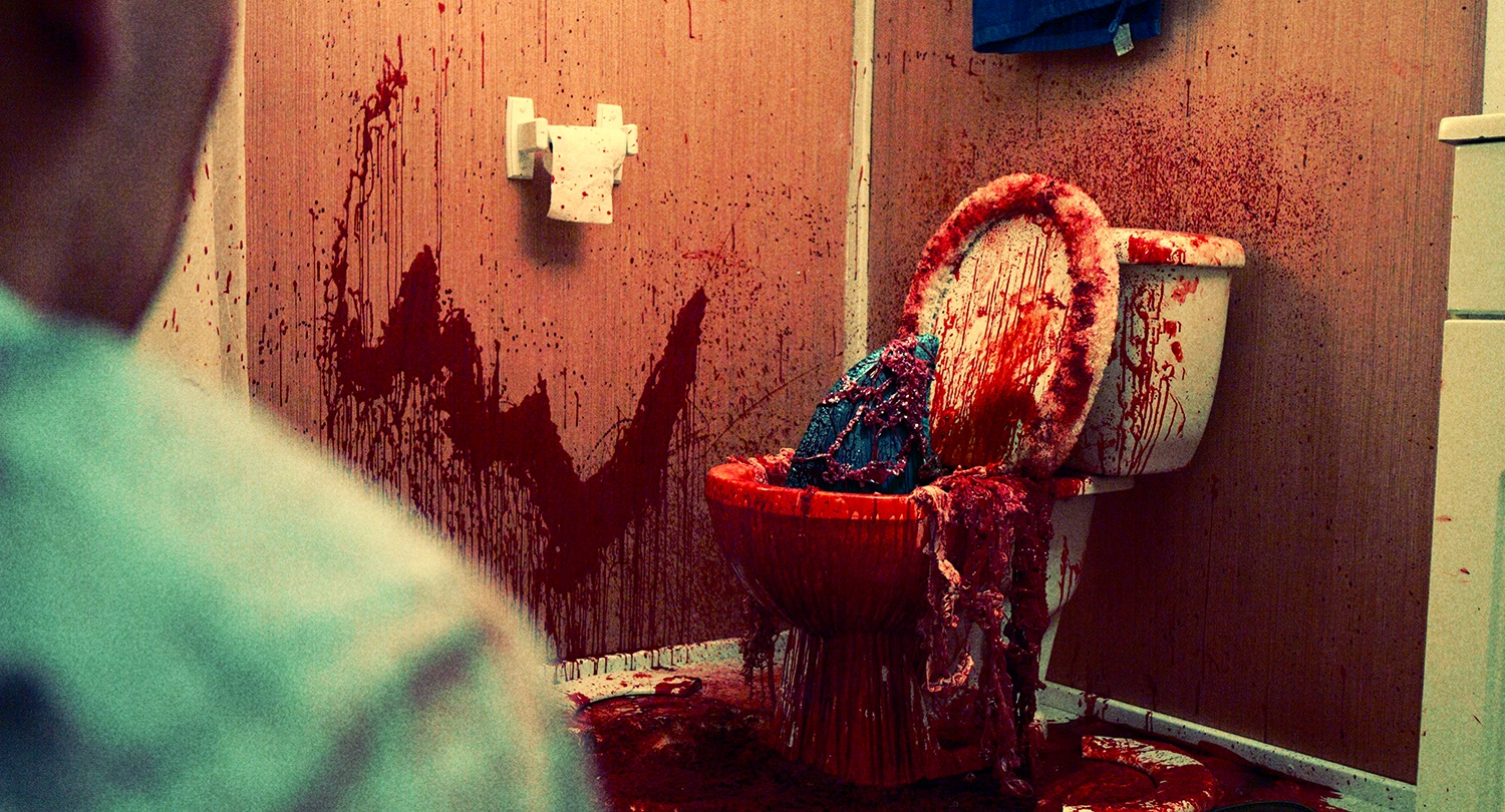 The house shark emerges from a toilet in House Shark (2017)