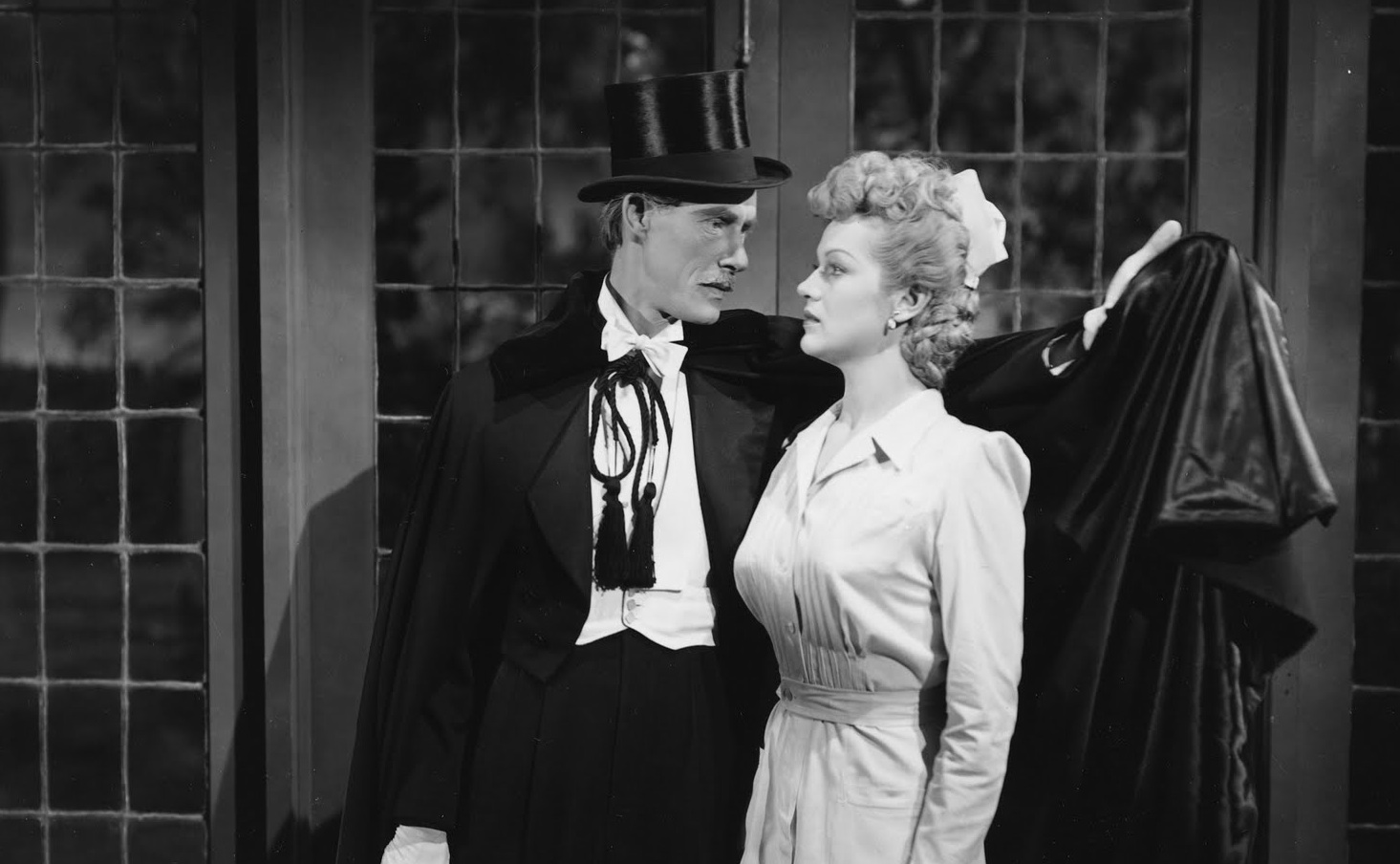 Dracula (John Carradine) makes the moves on nurse Martha O'Driscoll in House of Dracula (1945)