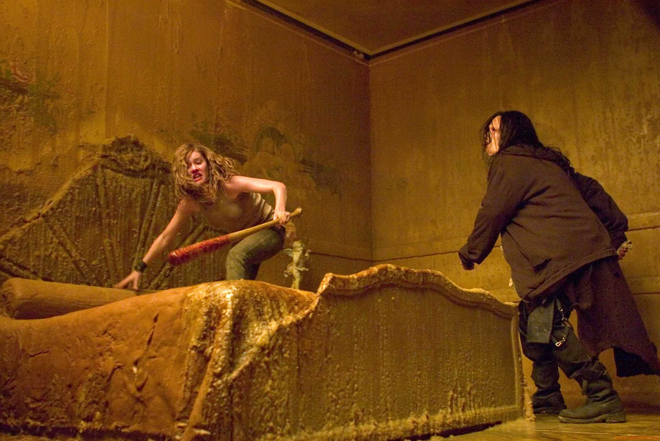 Elisha Cuthbert pursued by Brian Van Holt through the House of Wax (2005)