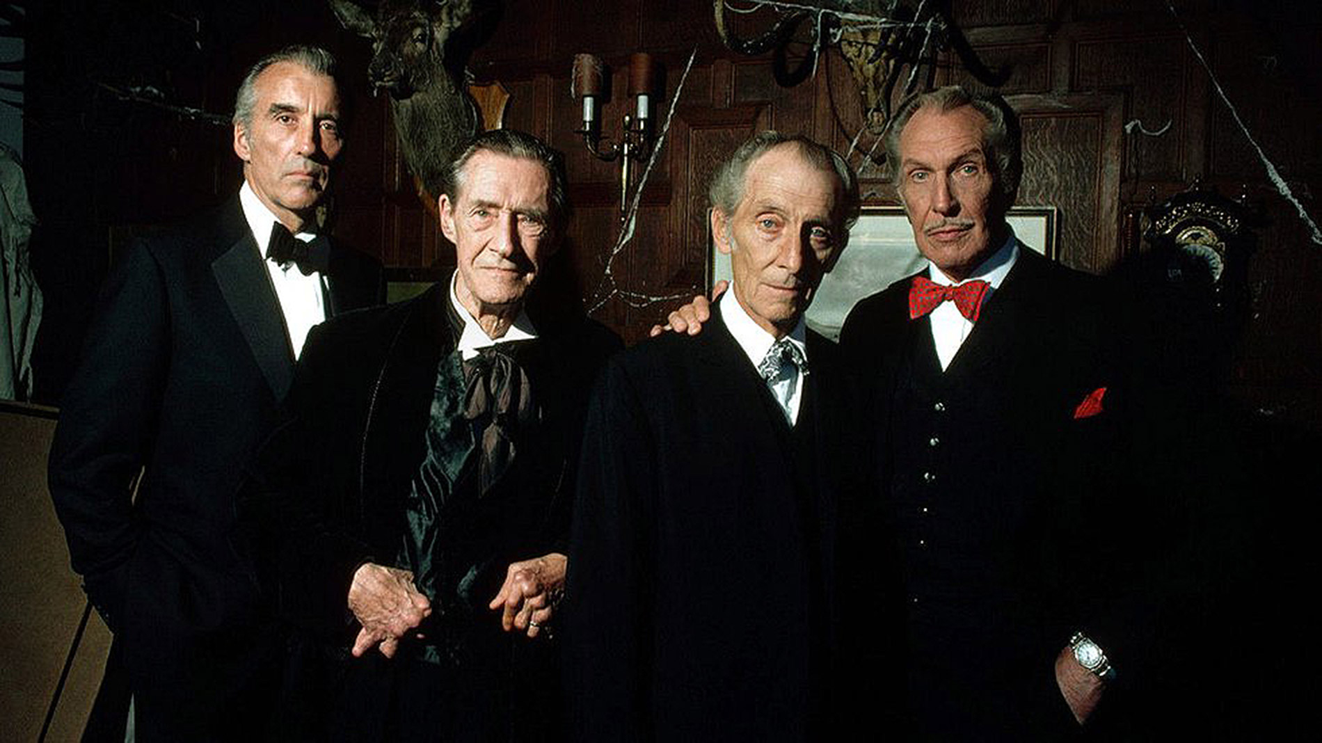 The uniting of four horror legends - (l to r) Christopher Lee, John Carradine, Peter Cushing and Vincent Price in House of the Long Shadows (1983)
