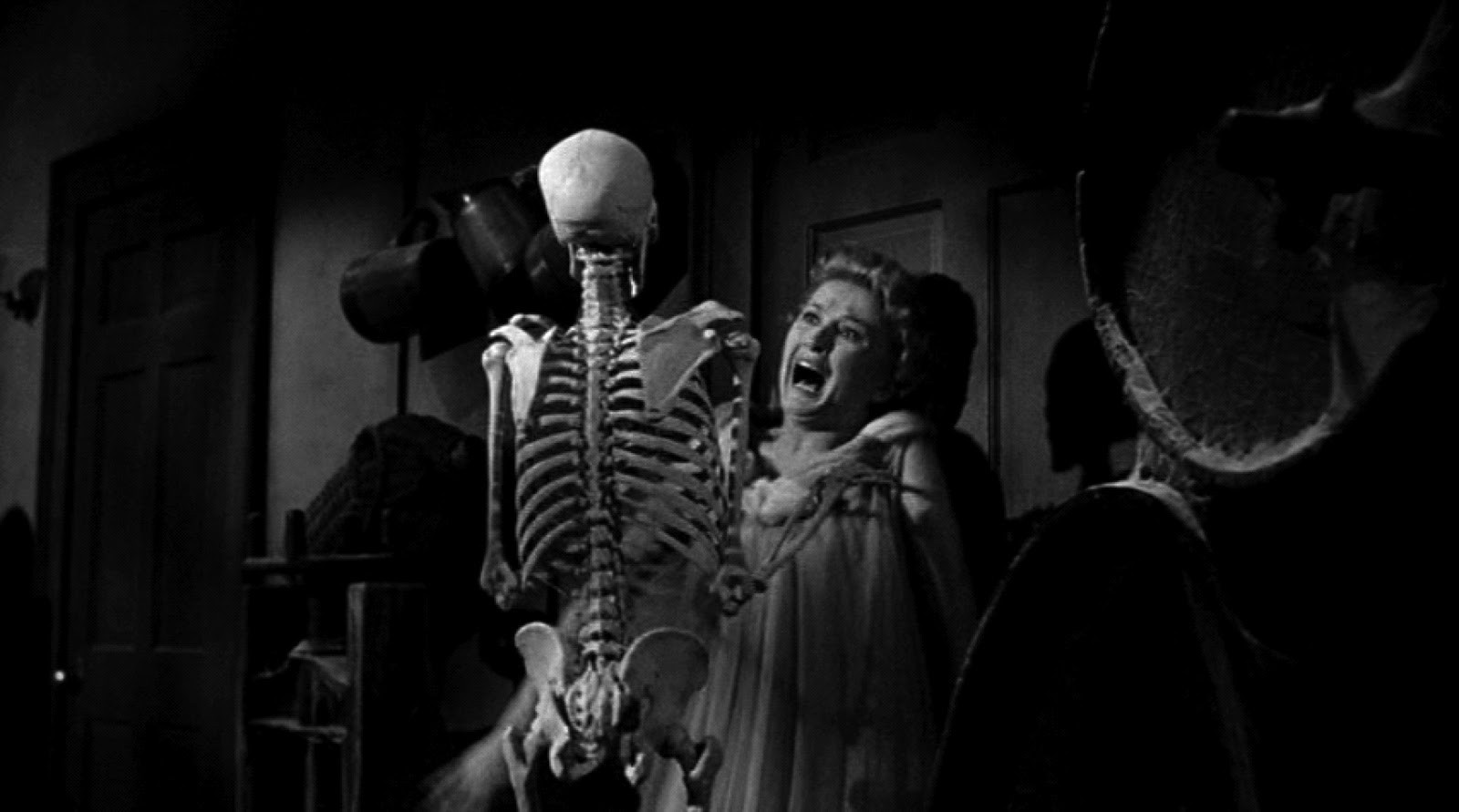 Carol Ohmart attacked by a skeleton in House on Haunted Hill (1959)
