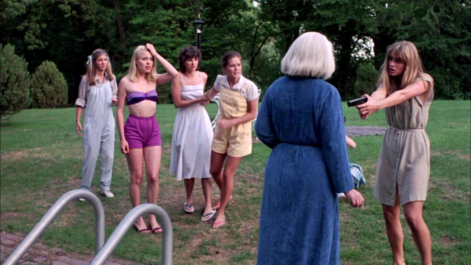 (l to r) Robin Meloy, Jodi Draigie, Ellen Dorsher, Kate McNeil and Eileen Davidson force Lois Kelso Hunt into the pool at gunpoint in The House on Sorority Row (1982)