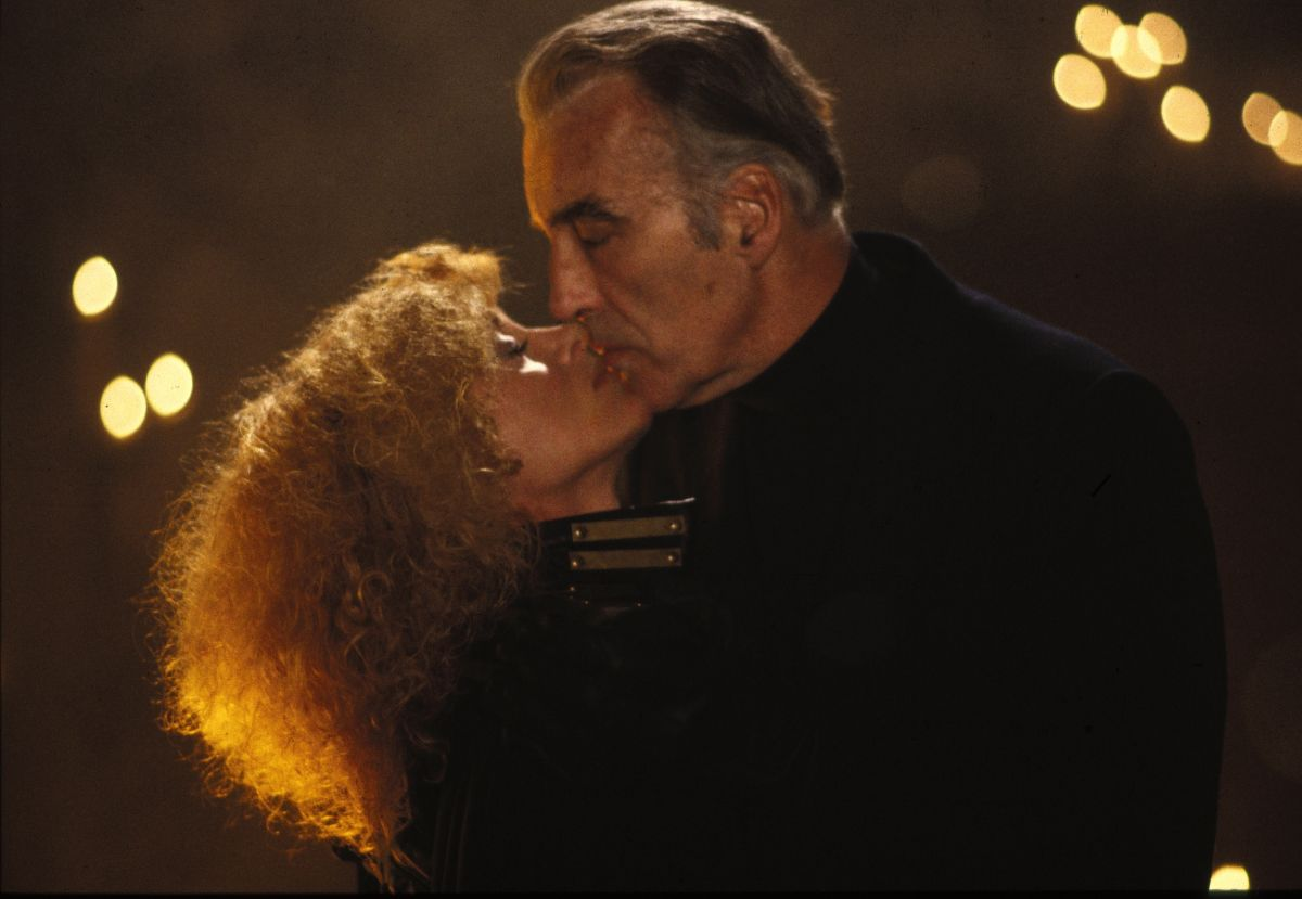 Stirba (Sybil Danning) and Stefan (Christopher Lee) share a kiss in The Howling II (1985)