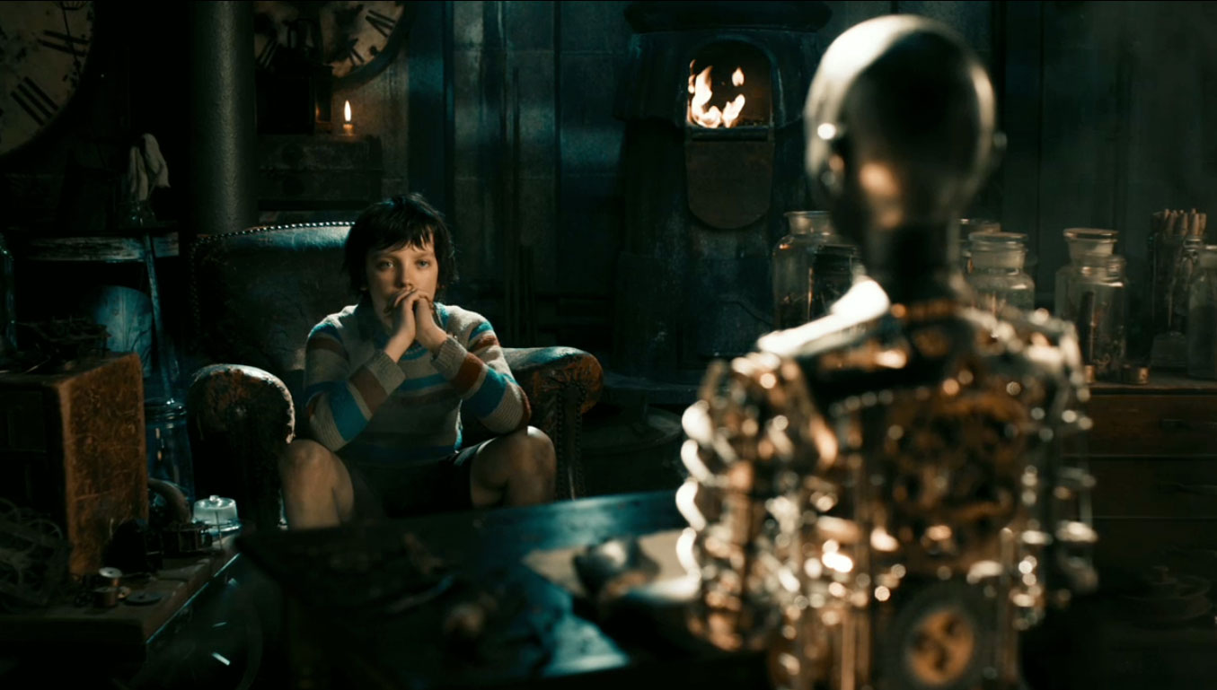 Asa Butterfield contemplates the automata in Hugo (2011)