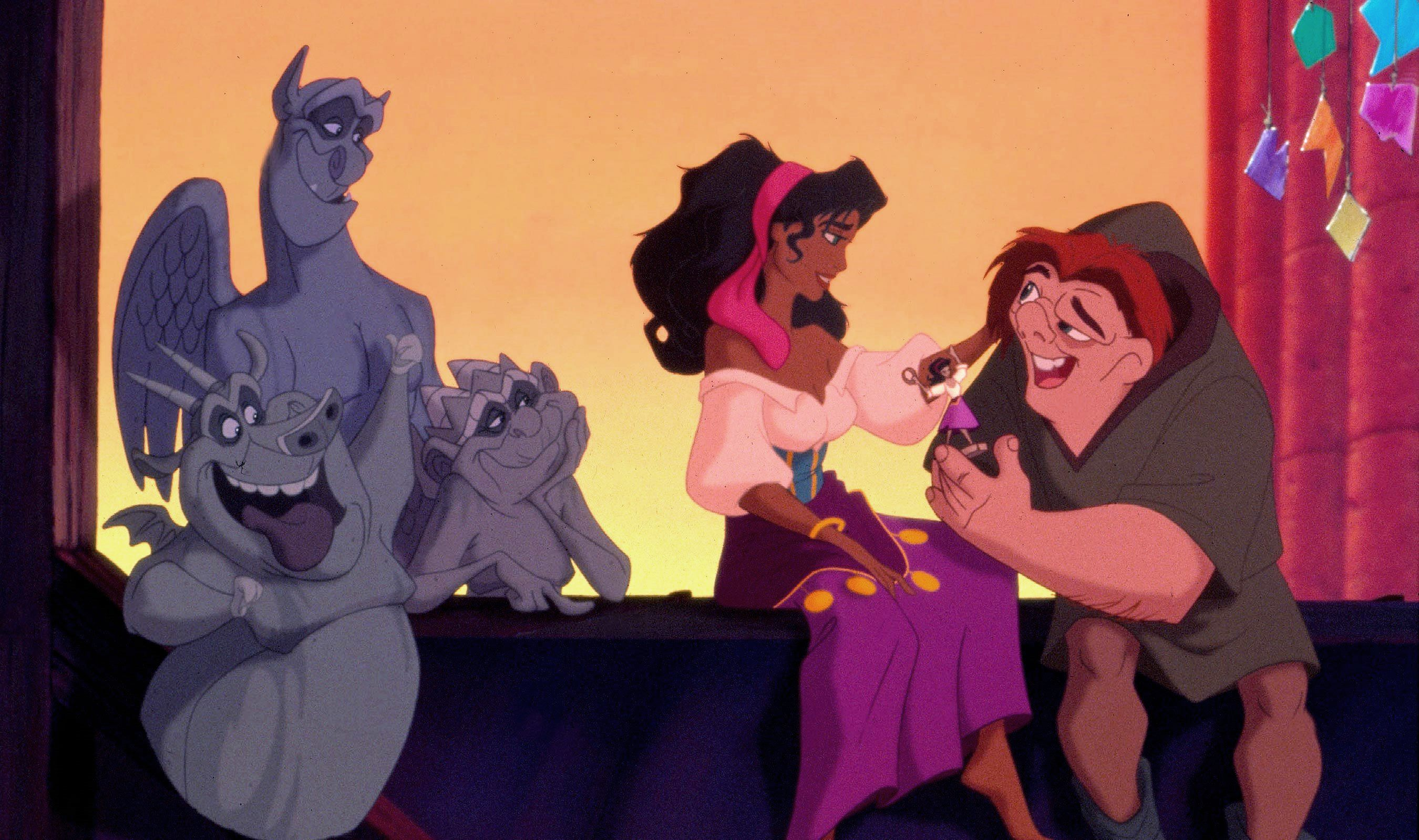 Quasi (voiced by Tom Hulce) expresses affection for Esmeralda (voiced by Demi Moore) as the trio of talking gargoyles look on in The Hunchback of Notre Dame (1996)