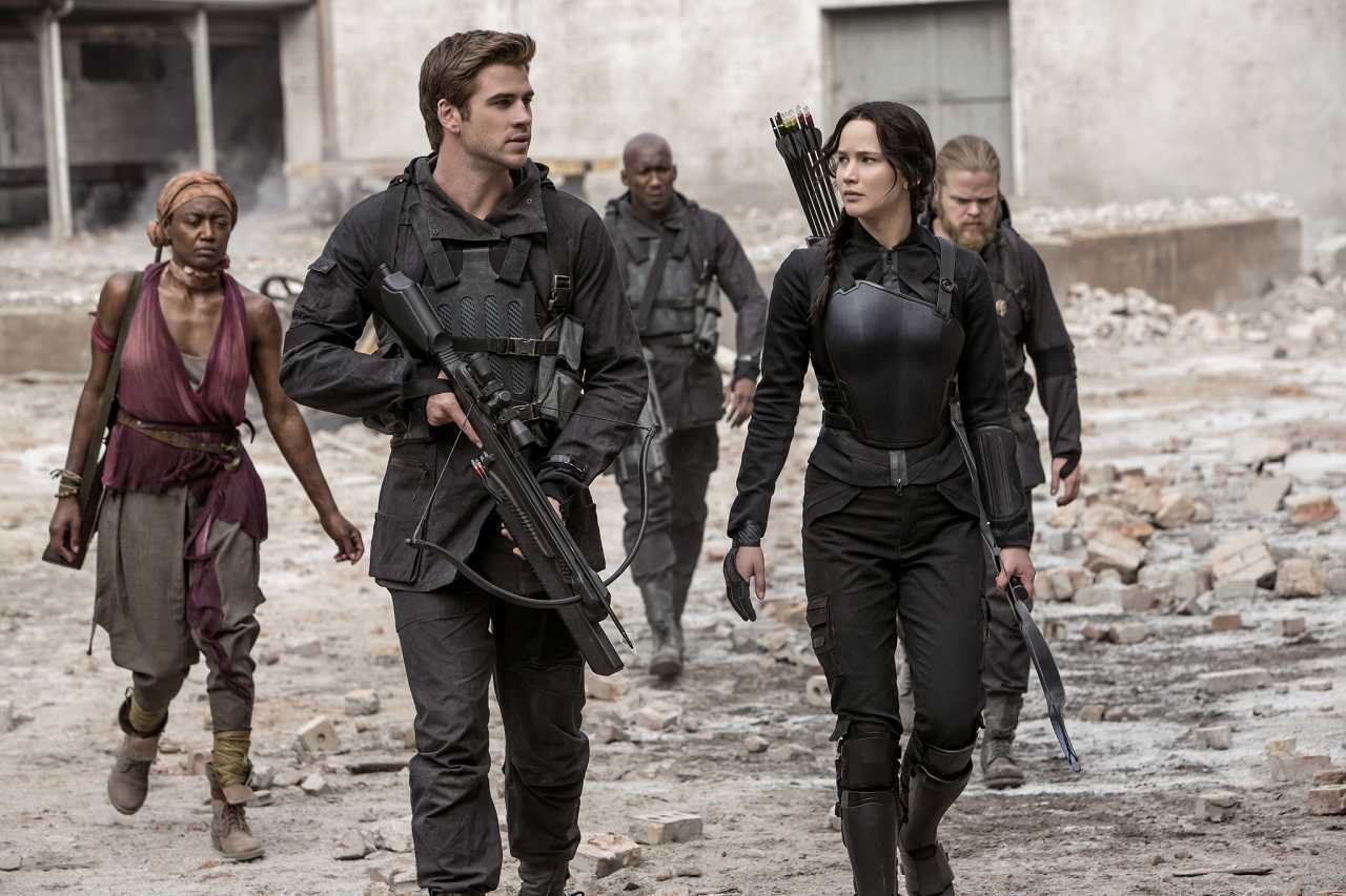 Liam Hemsworth, Jennifer Lawrence, Patina Miller, Mahershala Ali and Eldon Henson in The Hunger Games: Mockingjay Part 1 (2014)