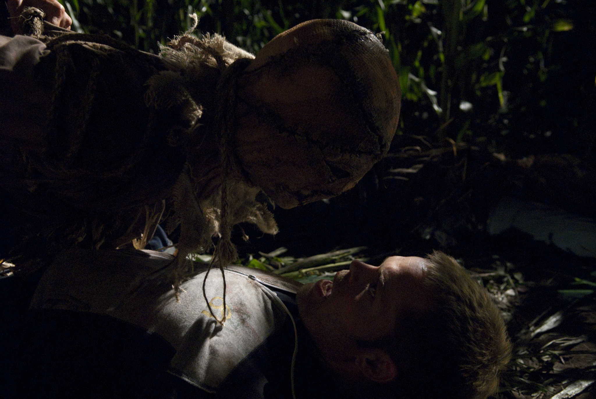 Wes Chatham attacked by a scarecrow in Husk (2011)