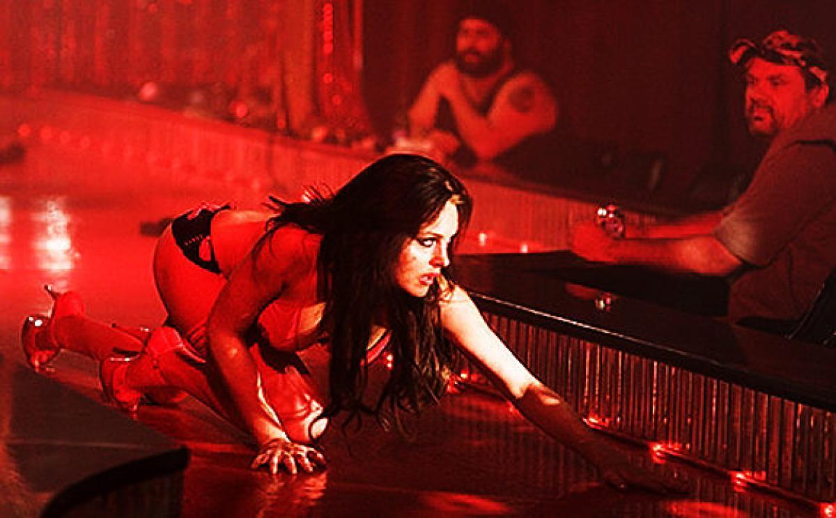 Lindsay Lohan as stripper Dakota Moss in I Know Who Killed Me (2007)