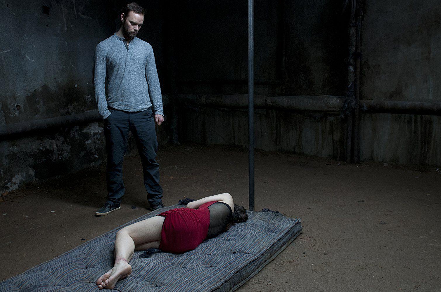 Joe Absolom stands over an imprisoned Jemma Dallender in I Spit on Your Grave 2 (2013)