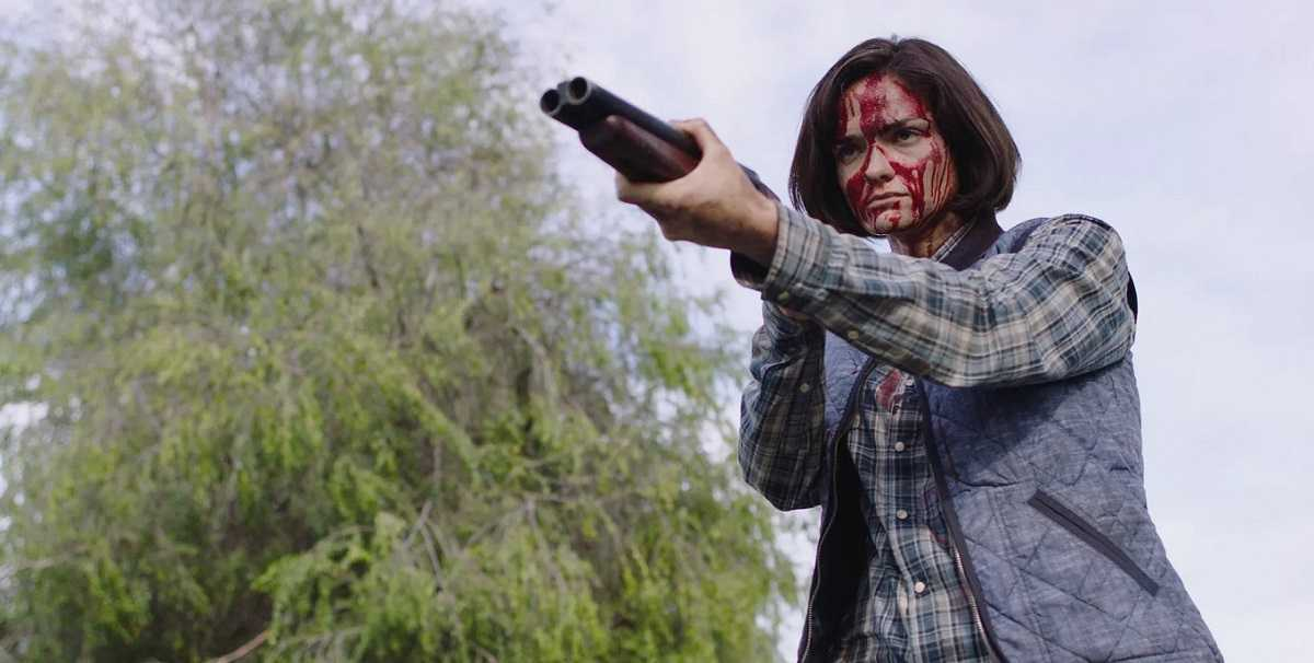 Jamie Bernadette as Jennifer Hill's daughter on the revenge trail after being subject to the same assault as her mother in I Spit on Your Grave: Deja Vu (2019)