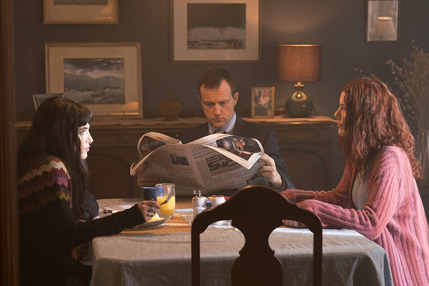 Bella Thorne (l) and mother Amy Price-Frances (r) eat breakfast along with the remnant of her father (Shaun Benson) (c) in I Still See You (2018)