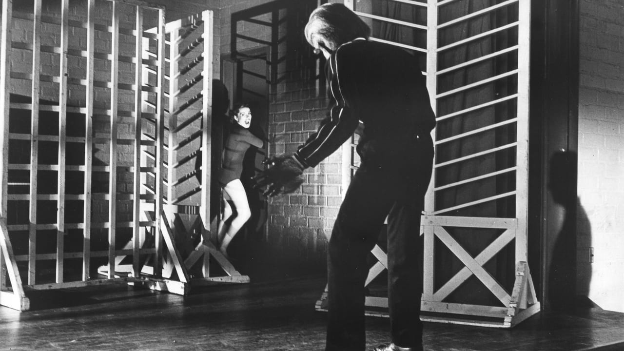 Michael Landon pursues a girl through a gymnasium in I Was a Teenage Werewolf (1957)
