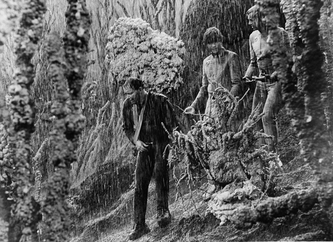 Astronauts in the torrential downpour of Venus in The Long Rains episode of The Illustrated Man (1969)