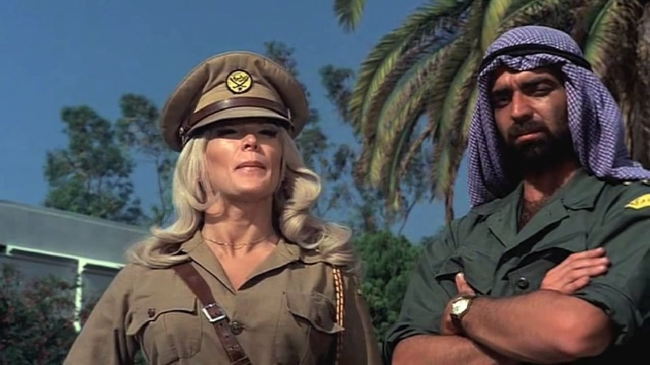 Ilsa (Dyanne Thorne) with the sheif El Sharif (Victor Alexander/Jerry Delony) in Ilsa, Harem Keeper of the Oil Sheiks (1976)