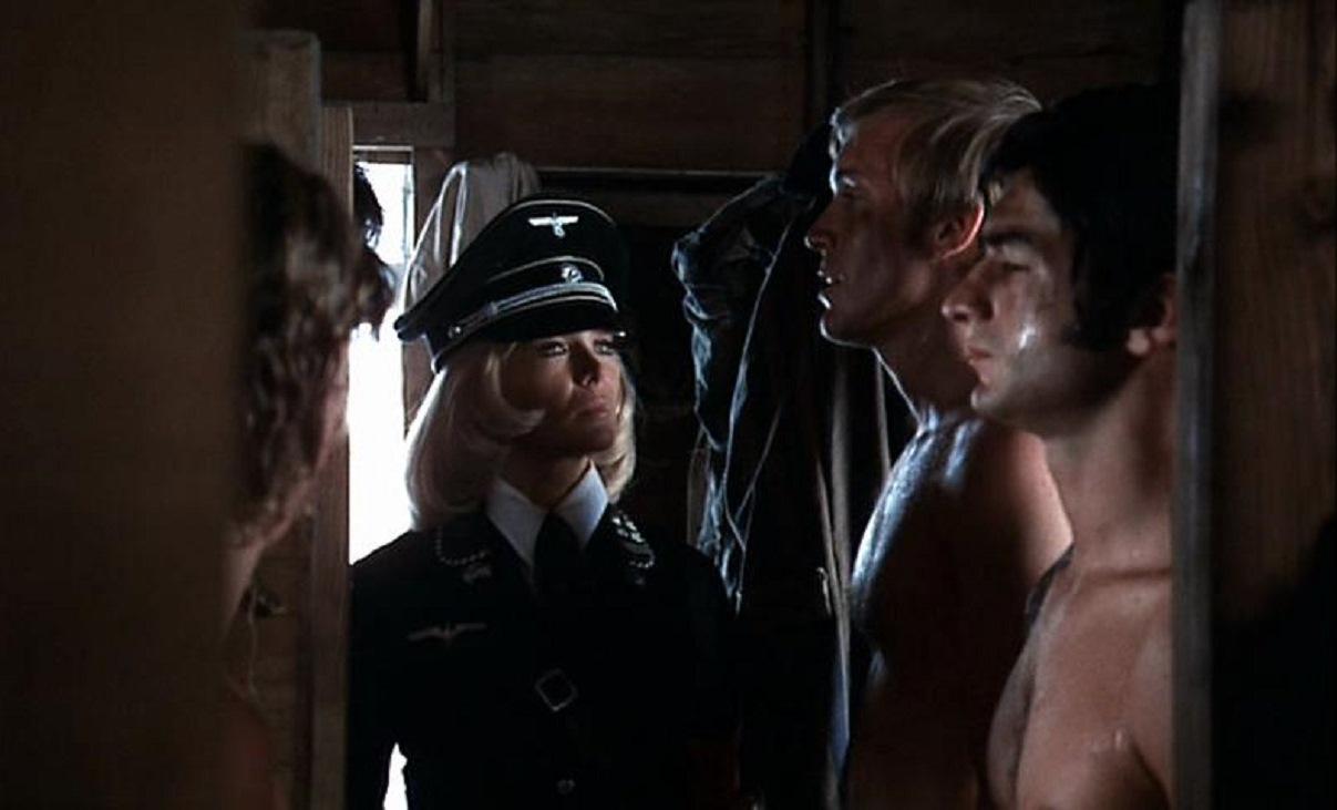 Ilsa (Dyanne Thorne) surveys the prisoners in Ilsa, She Wolf of the SS (1974)