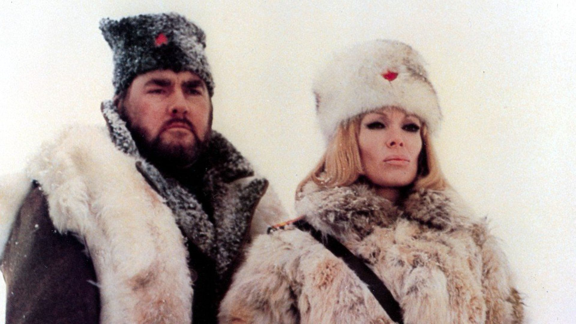 Dyanne Thorne as the commandant of a Soviet gulag in Ilsa, The Tigress of Siberia (1977)