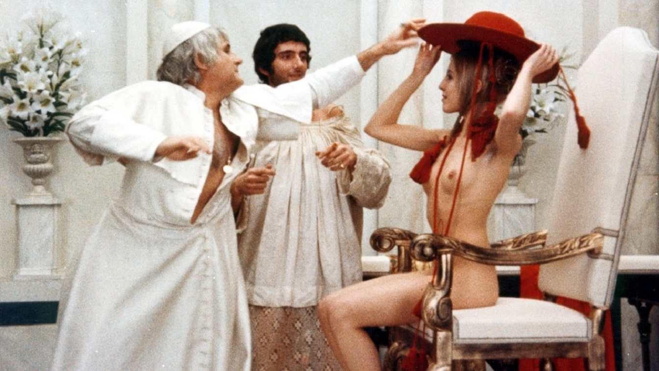 Pope Alexander (Jacopo Berinzini) helps Lucrezia (Florence Bellamy) with her attire in the Lucrezia Borgia episode of Immoral Tales (1974)