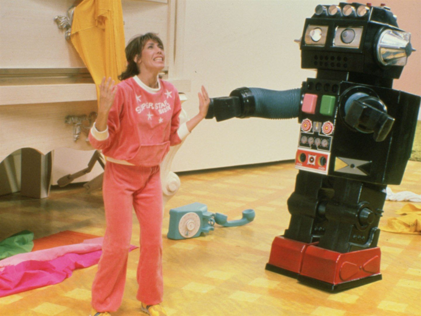 Shrunken housewife Pat Kramer (Lily Tomlin) and toy robot in The Incredible Shrinking Woman (1981)