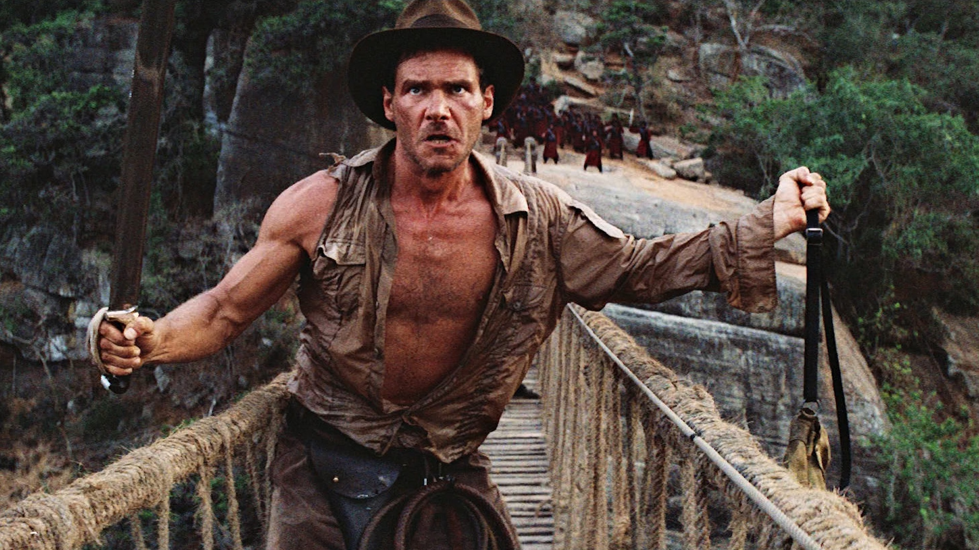 Harrison Ford trapped on the rope bridge in Indiana Jones and the Temple of Doom (1984)