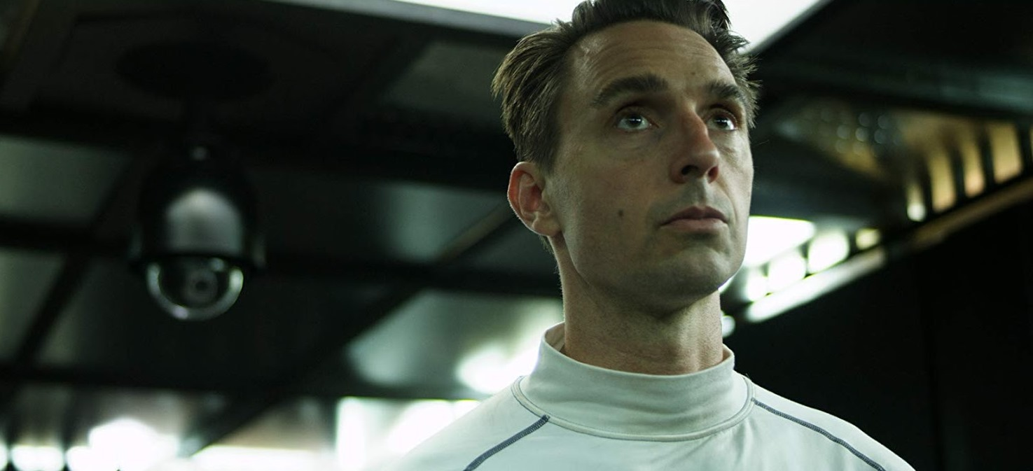 Christopher Soren Kelly in an automated prison with the A.I. Howard in Infinity Chamber (2016)
