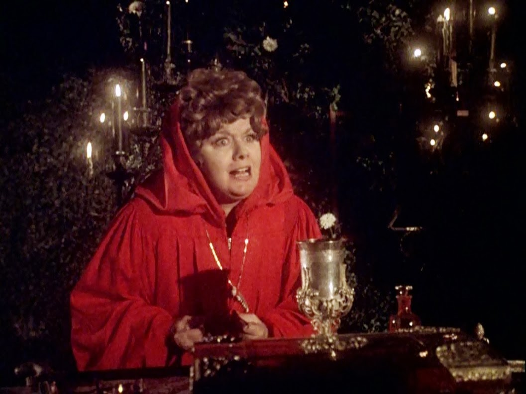 Mrs Hunter (Shelley Winters) leads occult rites in the sorority house in The Initiation of Sarah (1978)