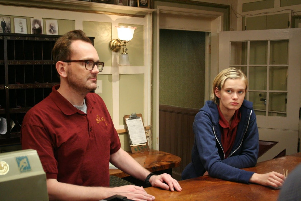 Hotel desk clerks Pat Healy and Sara Paxton in The Innkeepers (2011)