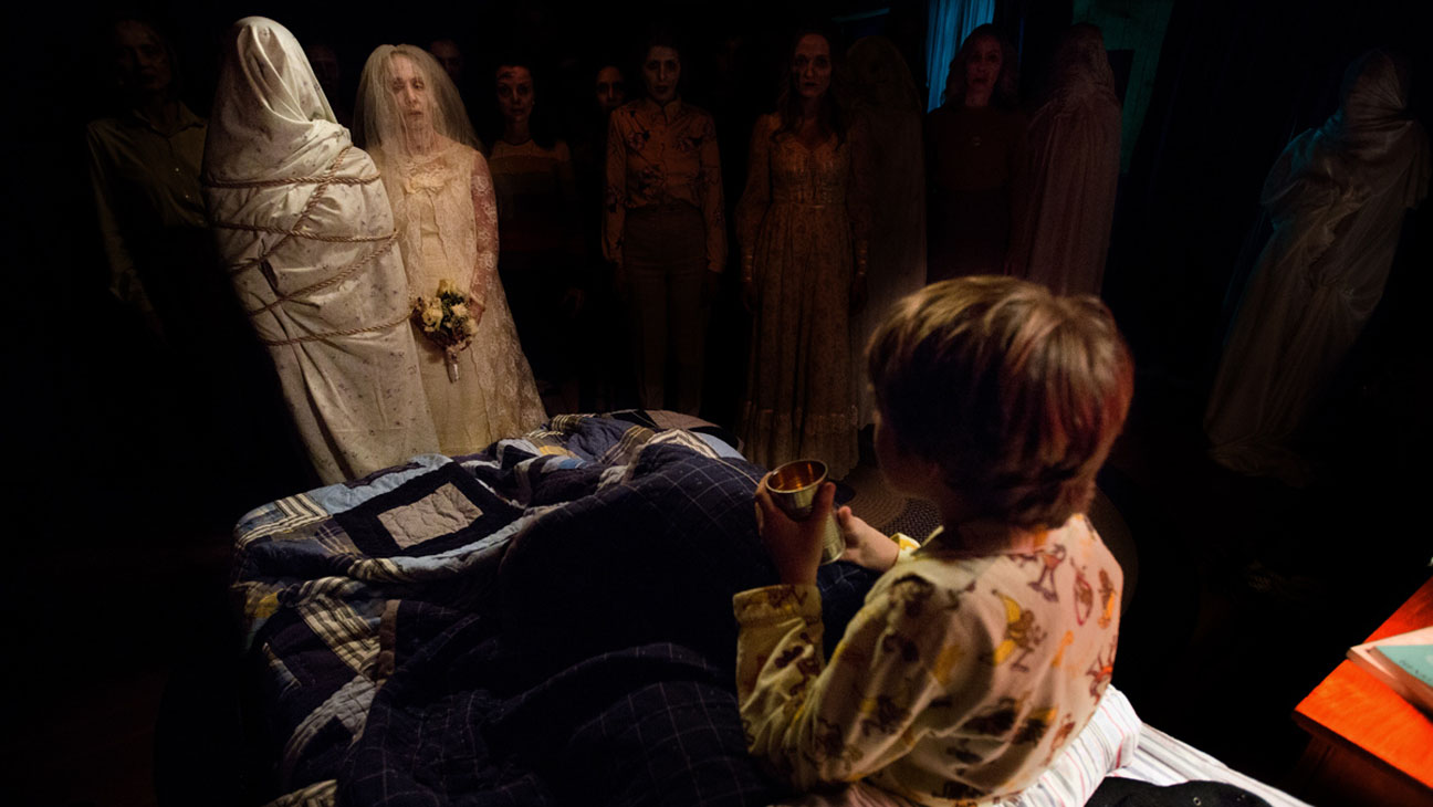 Ty Simpkins surrounded by ghosts in Insidious Chapter 2 (2013)