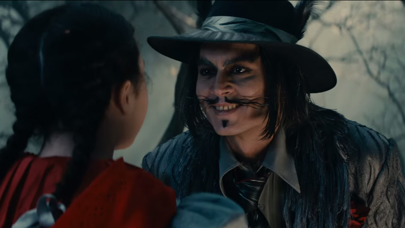The Wolf (Johnny Depp) woos Little Red Riding Hood (Lilla Crawford) in Into the Woods (2014)