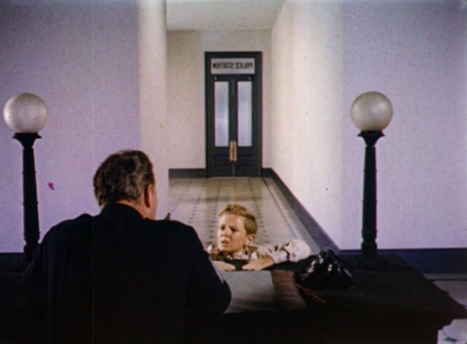 Young Jimmy Hunt at the police station in Invaders from Mars (1953)