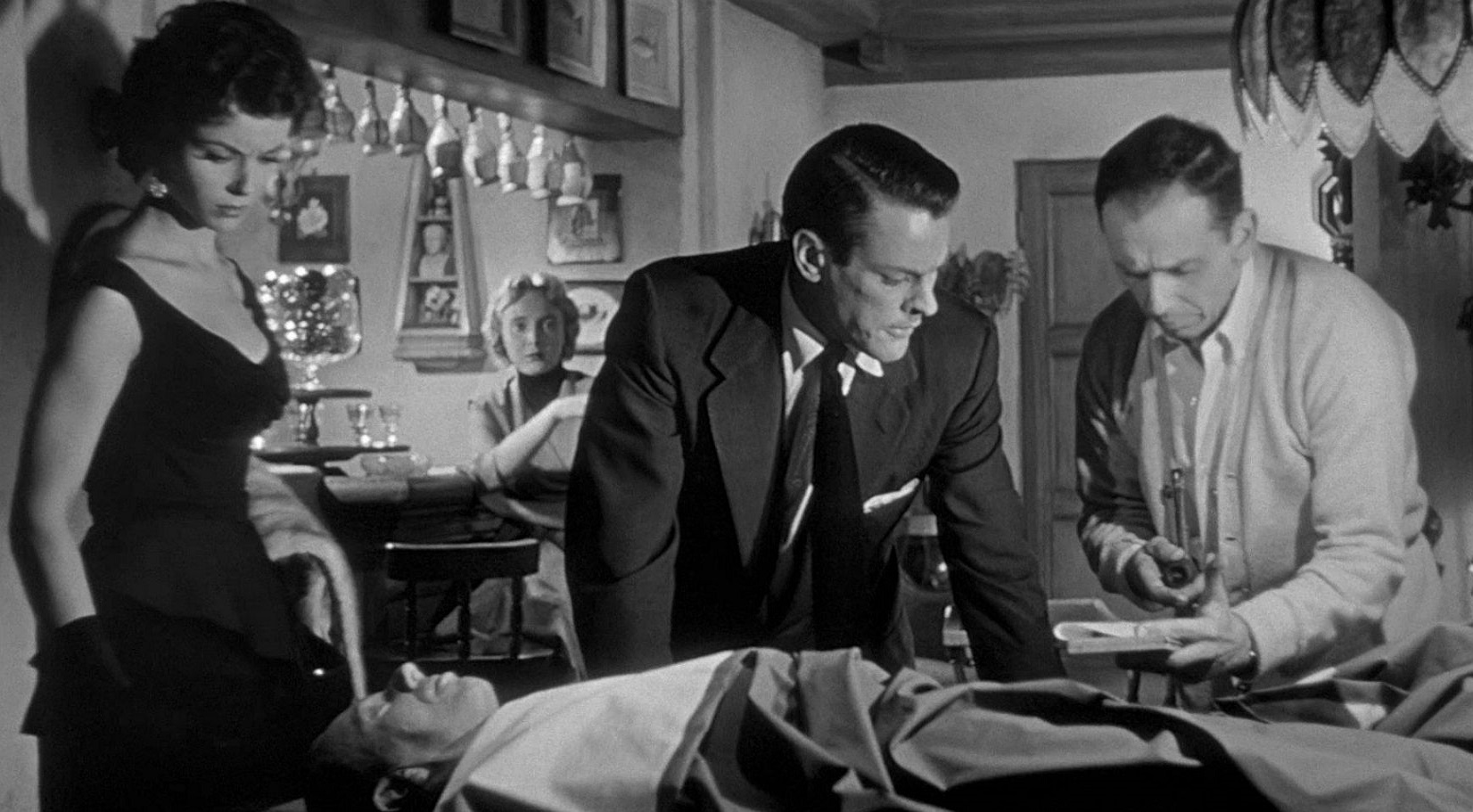 Dana Wynter, Kevin McCarthy and King Donovan examine the blank duplicate of Donovan in Invasion of the Body Snatchers (1956)