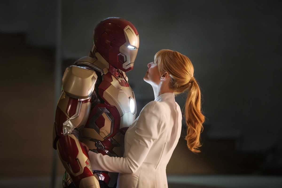 Iron Man (Robert Downey Jr) and Pepper Potts (Gwyneth Paltrow) share a tender moment in Iron Man Three (2013)