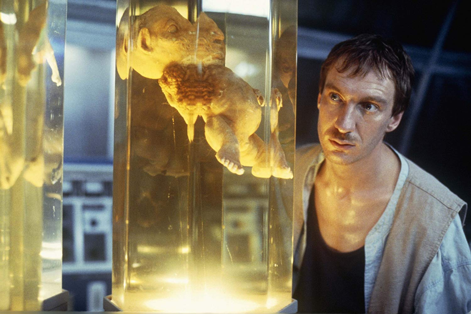 Castaway Edward Douglas (David Thewlis) views the experiments in the lab in The Island of Dr Moreau (1996)