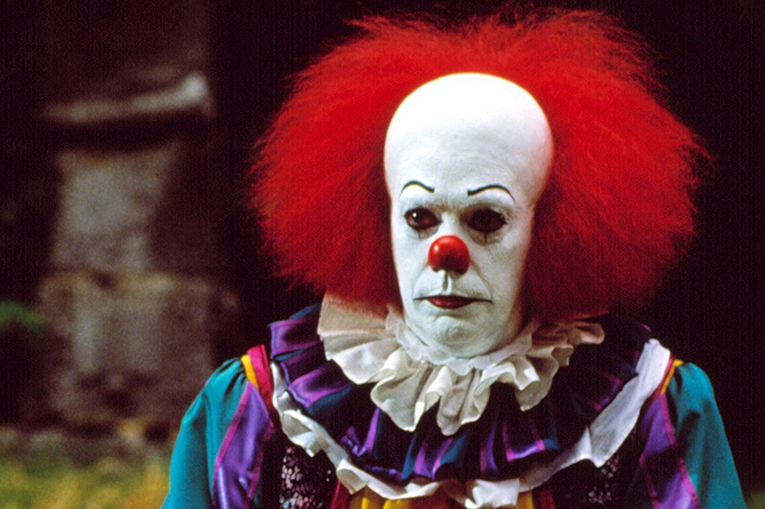 Tim Curry as Pennywise in It (1990)