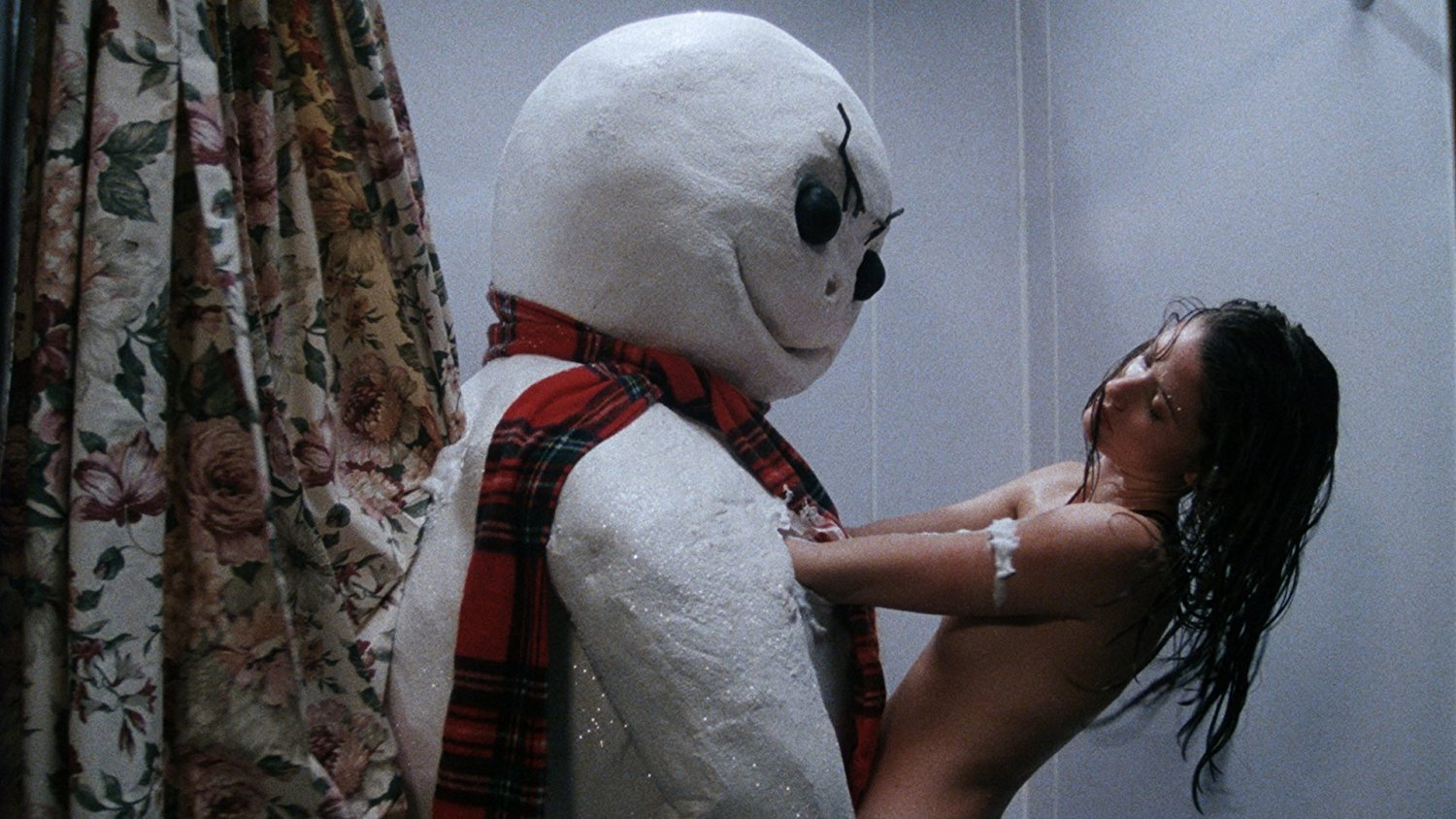 The killer snowman joins Shannon Elizabeth Fadal for a shower in Jack Frost (1997)