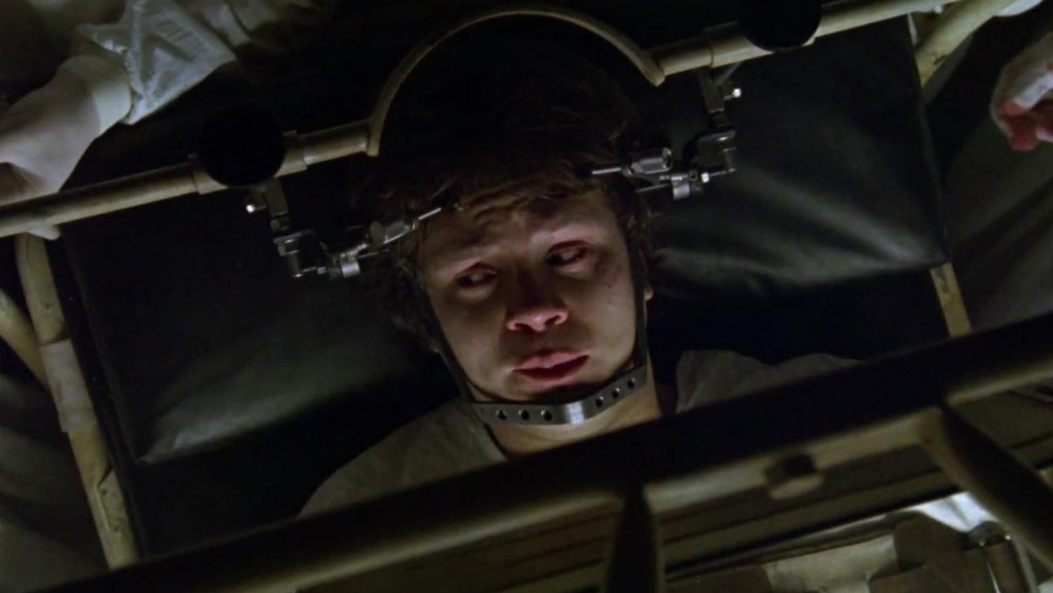 Jacob (Tim Robbins) drawn into a nightmare in which he is tortured in a hospital in Jacob's Ladder (1990)