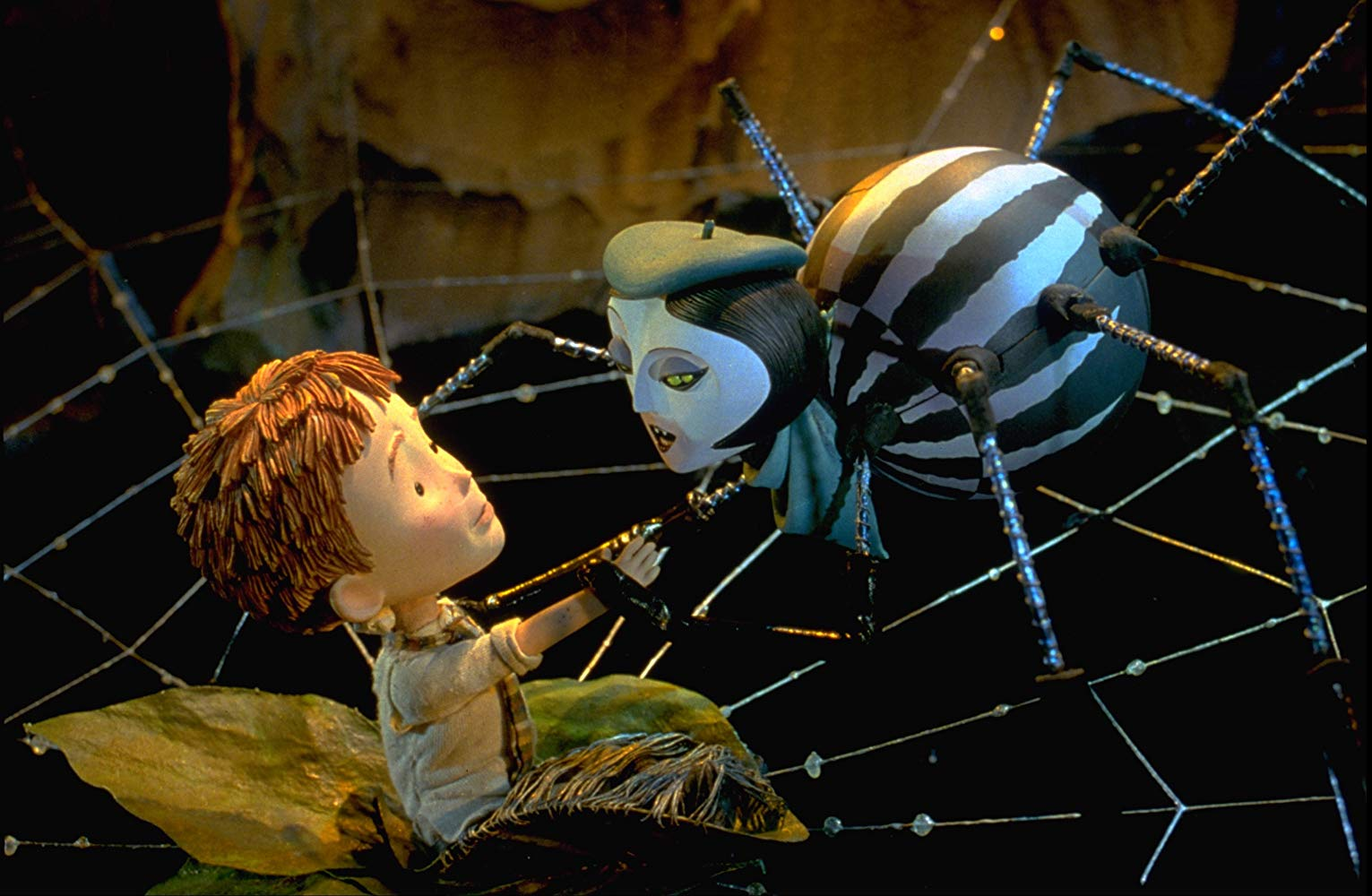 James (voiced by Paul Terry) and Spider (voiced by Susan Sarandon) in James and the Giant Peach (1996)