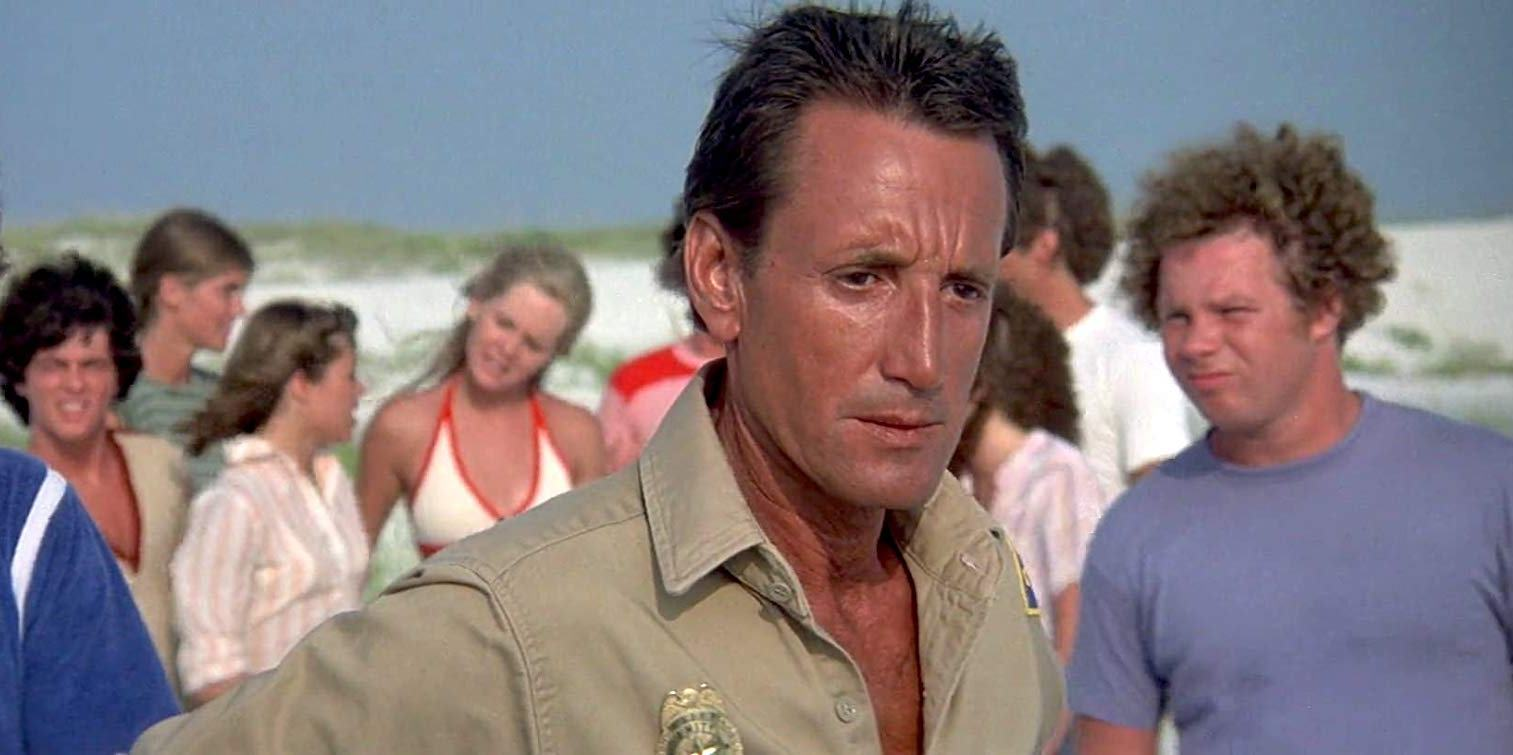 A paranoid Sheriff Brody (Roy Scheider) sees sharks everywhere in Jaws 2 (1978)